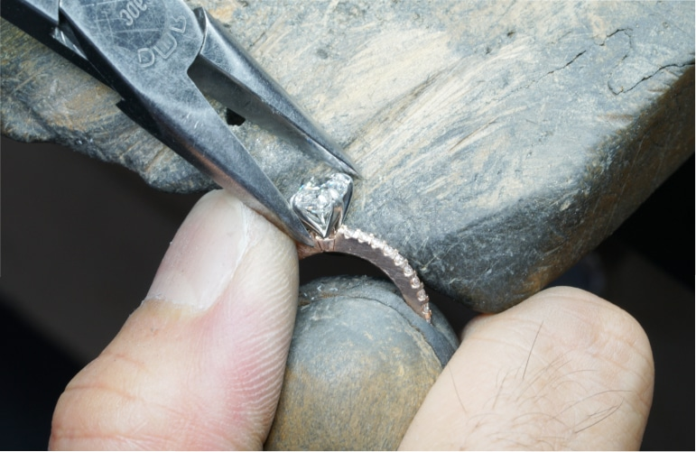 Jeweller repairing diamond ring